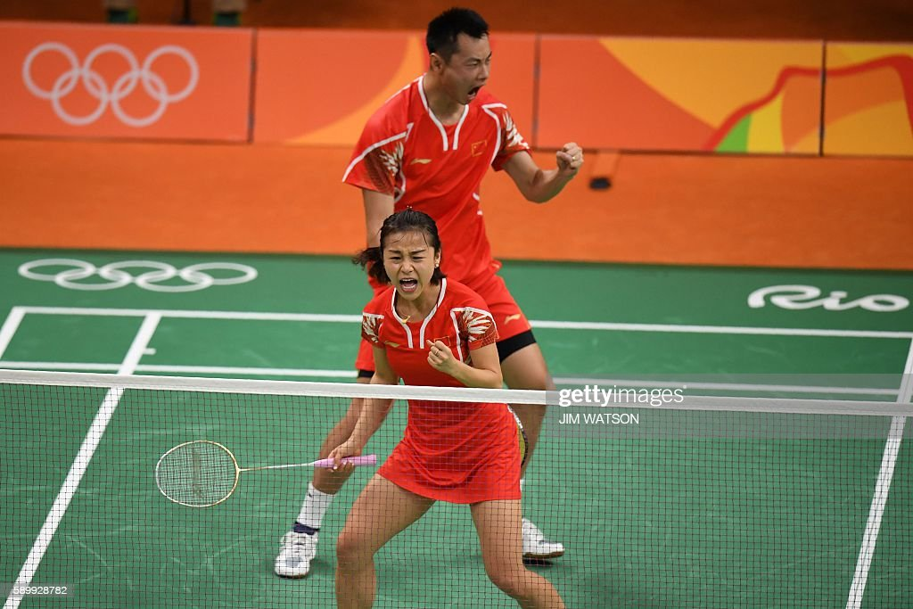 China's Xu Chen and China's Ma Jin reacts against Malaysia's Peng Soon Chan and Malaysia's Liu Ying Goh during their mixed doubles semifinal...