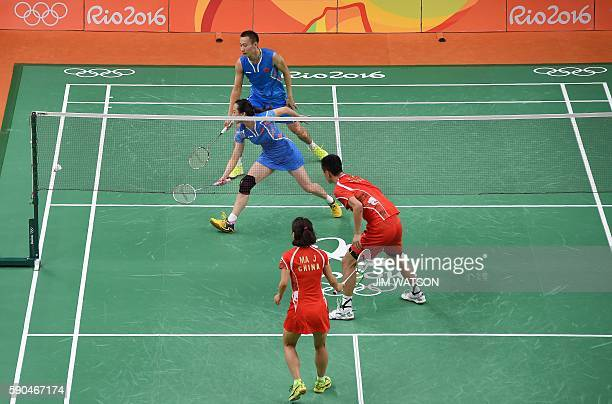 China's Xu Chen and China's Ma Jin return to China's Zhang Nan and China's Zhao Yunlei to lose the mixed doubles Bronze Medal badminton match at the...