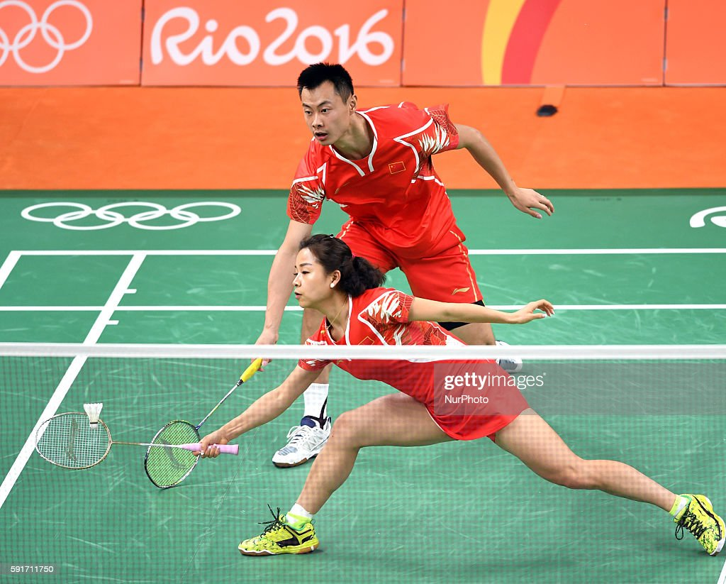 China's Xu Chen and Ma Jin compete during the mixed doubles bronze medal match of Badminton against China's Zhang Nan and Zhao Yunlei at the 2016 Rio...