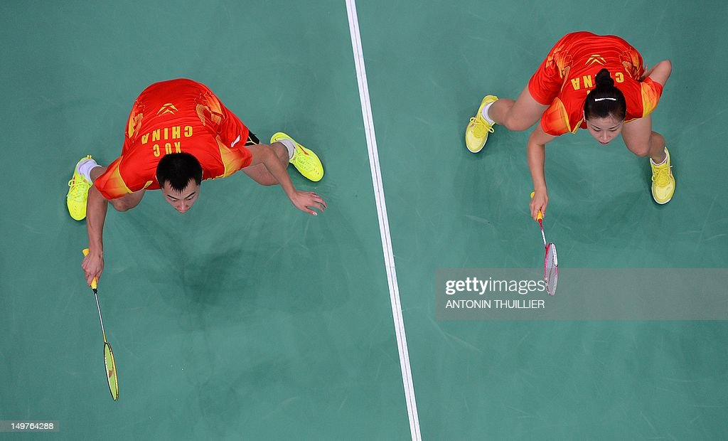 China's Xu Chen (L) and Ma Jin play against compatriots Zhang Nan and Zhao Yunlei during the Mixed Doubles gold medal match at the London 2012 Olympic Games in London, on August 3, 2012.