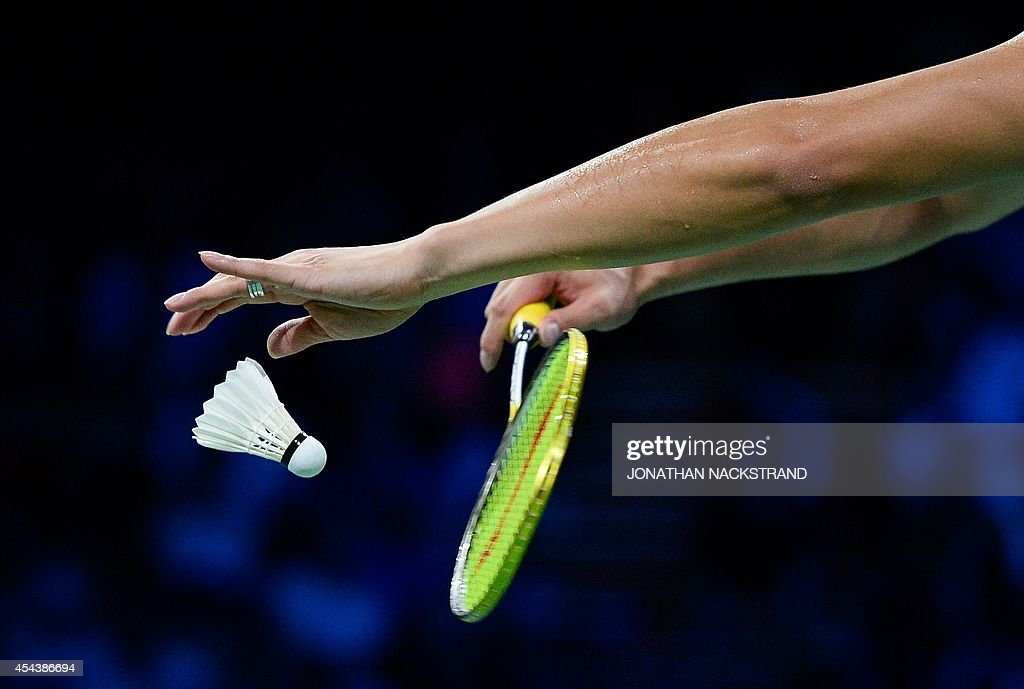 China's Xu Chen serves a ball while competing with China's Ma Jin against Denmark's Joachim Fischer Nielsen and Christinna Pedersen during the mixed...