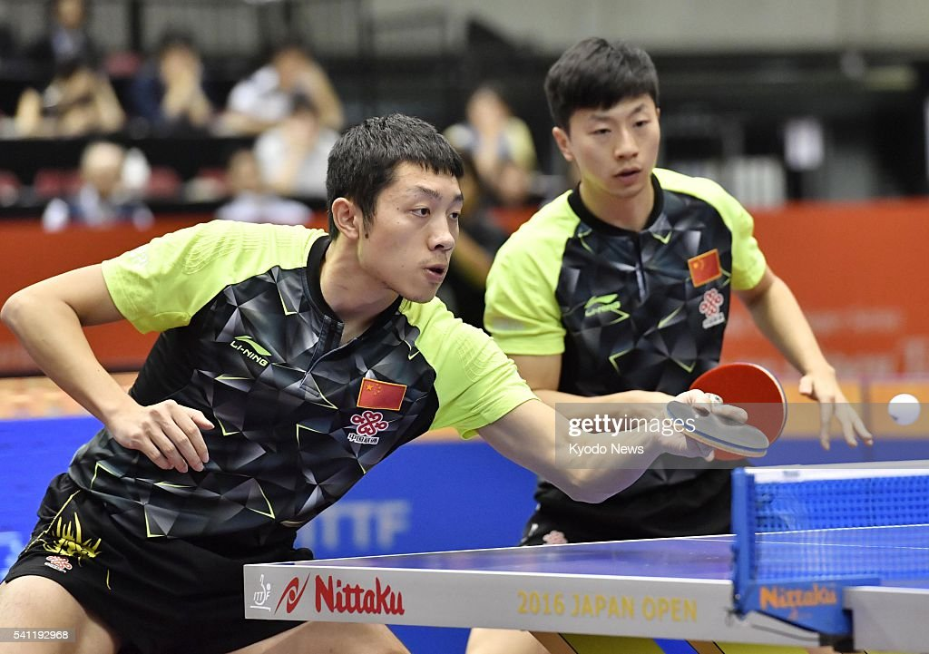 China's <a gi-track='captionPersonalityLinkClicked' href=/galleries/search?phrase=Xu+Xin+-+Table+Tennis+Player&family=editorial&specificpeople=15781496 ng-click='$event.stopPropagation()'>Xu Xin</a> (L) hits a shot as countryman Ma Long looks on, during the men's doubles final of the International Table Tennis Federation (ITTF) World Tour Japan Open in Tokyo on June 19, 2016. They defeated the Taiwanese pair of Chuang Chih-yuan and Huang Sheng-sheng 3-0 to secure the title. ==Kyodo