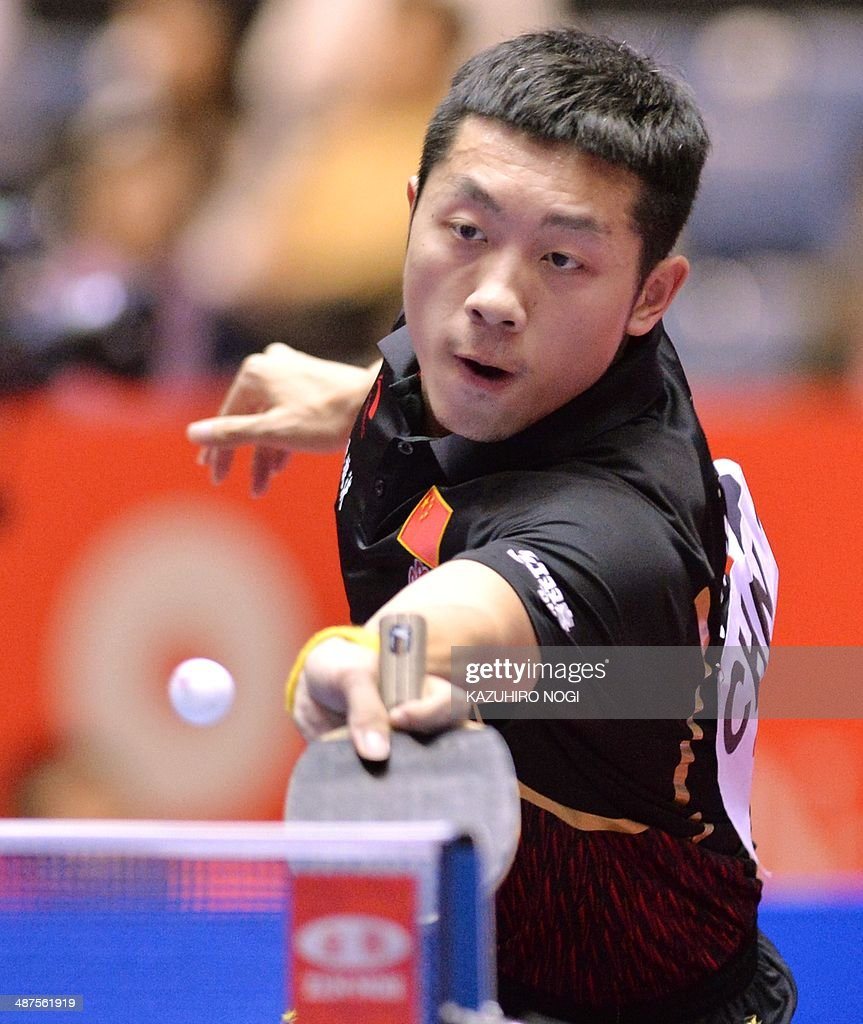 China's Xu Xin returns a shot against Serbia's Zolt Pete during their match in the men's team championship division group A at the 2014 World Team Table Tennis Championships in Tokyo on May 1, 2014.