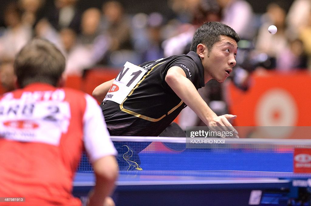 China's Xu Xin (R) serves against Serbia's Zolt Pete during their match in the men's team championship division group A at the 2014 World Team Table Tennis Championships in Tokyo on May 1, 2014.
