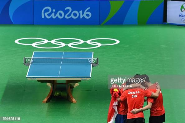 China's Xu Xin Zhang Jike and Ma Long celebrate winning the men's team gold medal table tennis match against Japan at the Riocentro venue during the...