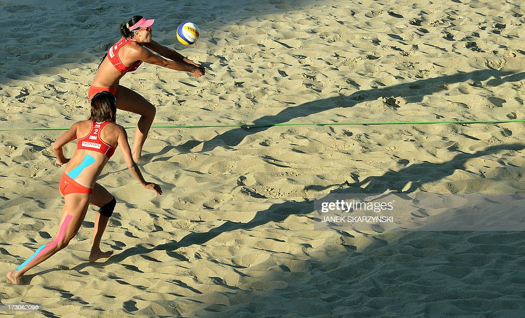 China's Xue Chen (L) and Zhang Xi play against Germany's Karla Borger and Britta Buethe (not pictured) in the final match of the Beach Volleyball World Championships on July 6, 2013 in Stare Jablonki.