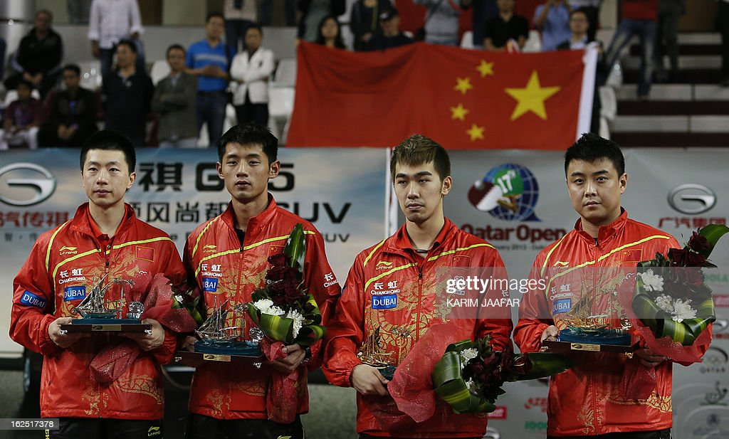 China's Yan An (2nd-R) and Wang Hao (R) pose with the winner trophies next to second place winners China's Ma Long (L) and Jike Zhang after the men's doubles final table tennis match at the ITTF Pro Tour Qatar Open in the Qatari capital Doha on February 24, 2013.