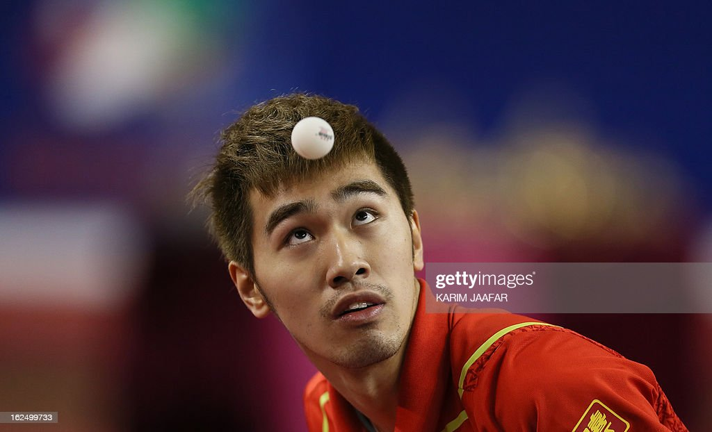 China's Yan An eyes the ball as he hits a return to China's Wang Hao during the men's singles semi-final table tennis match of the ITTF Pro Tour Qatar Open on February 24, 2013 in the Qatari capital, Doha.