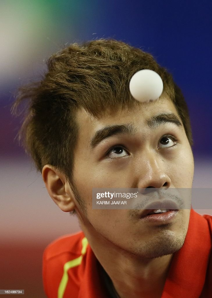 China's Yan An eyes the ball as he hits a return to China's Wang Hao during the men's singles semi-final table tennis match of the ITTF Pro Tour Qatar Open on February 24, 2013 in the Qatari capital, Doha. AFP PHOTO / AL-WATAN DOHA / KARIM JAAFAR == QATAR OUT ==