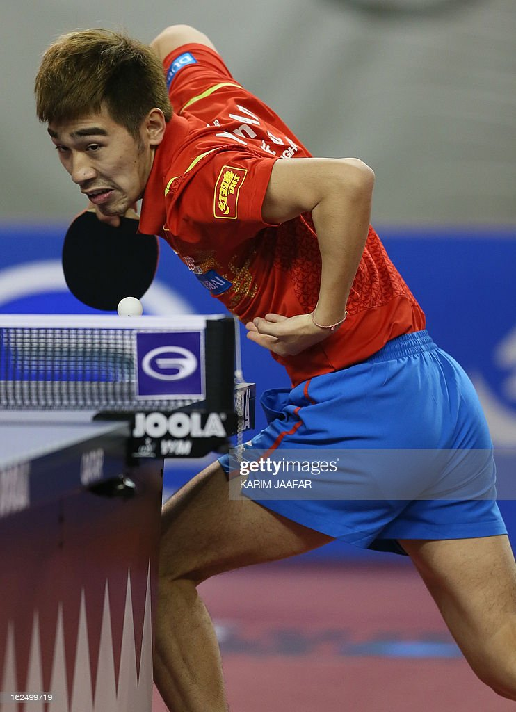 China's Yan An returns the ball to China's Wang Hao during the men's singles semi-final table tennis match of the ITTF Pro Tour Qatar Open on February 24, 2013 in the Qatari capital, Doha. AFP PHOTO / AL-WATAN DOHA / KARIM JAAFAR == QATAR OUT ==
