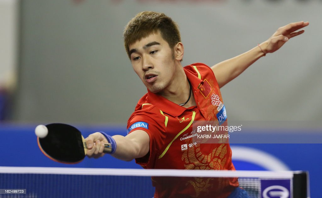 China's Yan An returns the ball to China's Wang Hao during the men's singles semi-final table tennis match of the ITTF Pro Tour Qatar Open on February 24, 2013 in the Qatari capital, Doha.