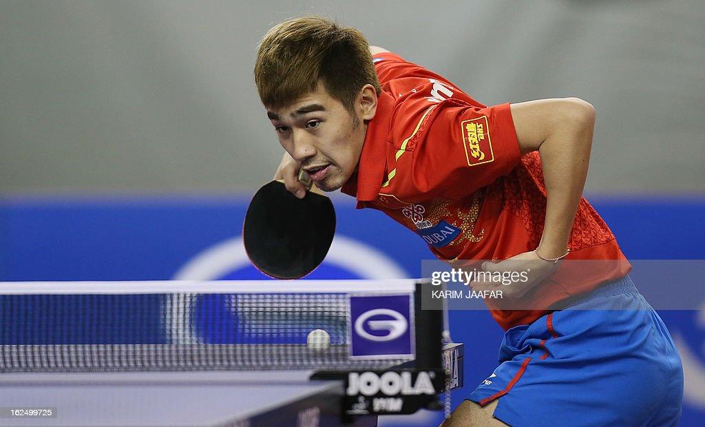 China's Yan An returns the ball to China's Wang Hao during the men's singles semi-final table tennis match of the ITTF Pro Tour Qatar Open on February 24, 2013 in the Qatari capital, Doha. AFP PHOTO / AL-WATAN DOHA / KARIM JAAFAR == QATAR OUT ==