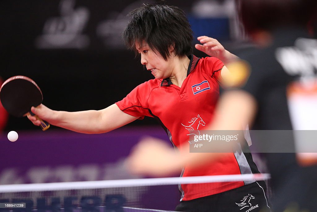 China's Yang Wu (L) plays against North Korea's Hye Song Kim on May 17, 2013 in Paris, during the fourth round of Women's Singles of the World Table Tennis Championships.