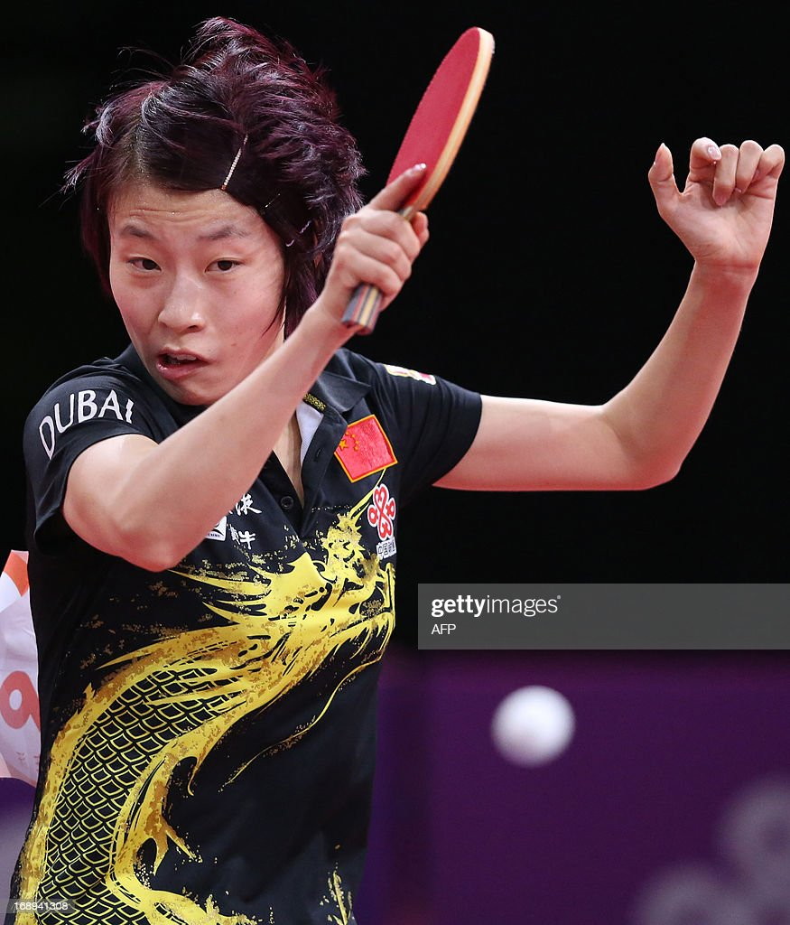 China's Yang Wu plays against North Korea's Hye Song Kim on May 17, 2013 in Paris, during the fourth round of Women's Singles of the World Table Tennis Championships. AFP PHOTO / THOMAS SAMSON