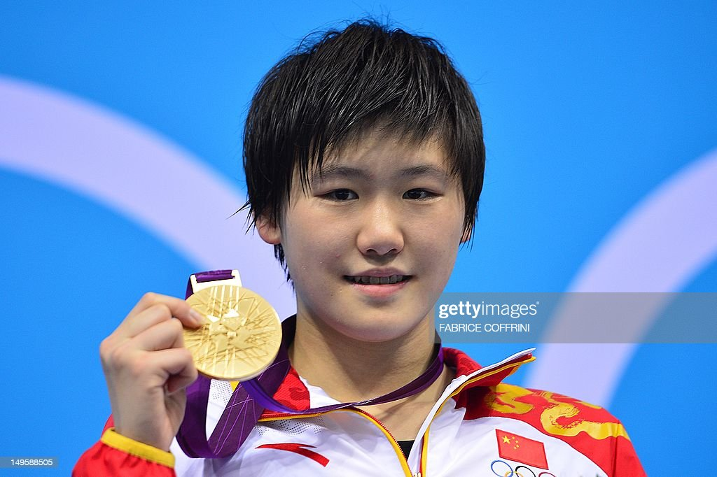 China's <a gi-track='captionPersonalityLinkClicked' href=/galleries/search?phrase=Ye+Shiwen+-+Swimmer&family=editorial&specificpeople=7402437 ng-click='$event.stopPropagation()'>Ye Shiwen</a> poses on the podium with the gold medal after winning the women's 200m individual medley final during the swimming event at the London 2012 Olympic Games on July 31, 2012 in London.