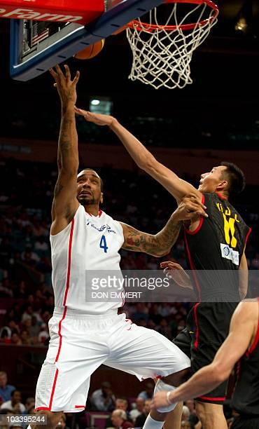 China's Yi Jianlian and Puerto Rico's Peter John Ramos during the Global Community Cup basketball exhibition game between Puerto Rico and China...
