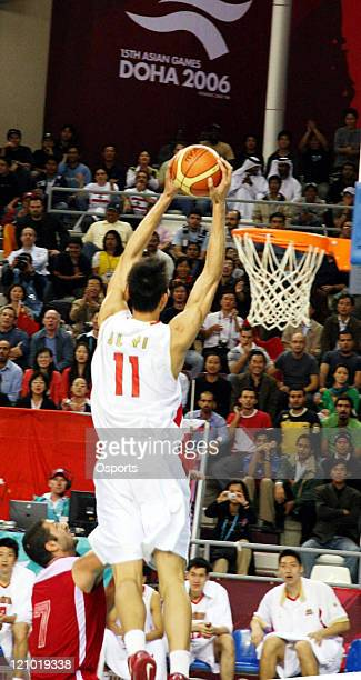 China's Yi Jianlian during the 15th Asian Games Doha 2006 Men's Basketball Preliminary Group F game between China and Lebanon at the Basketball...