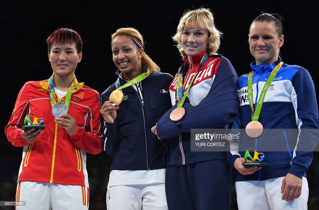 China's Yin Junhua, France's Estelle Mossely, Russia's Anastasiia Beliakova and Finland's Mira Potkonen pose on the podium with their medals following a boxing match at the Rio 2016 Olympic Games at the Riocentro - Pavilion 6 in Rio de Janeiro on August 19, 2016. Estelle Mossely celebrated her birthday in style by punching her way into the history books as she became the first Frenchwoman to win Olympic boxing gold on August 19, 2016. / AFP / Yuri CORTEZ
