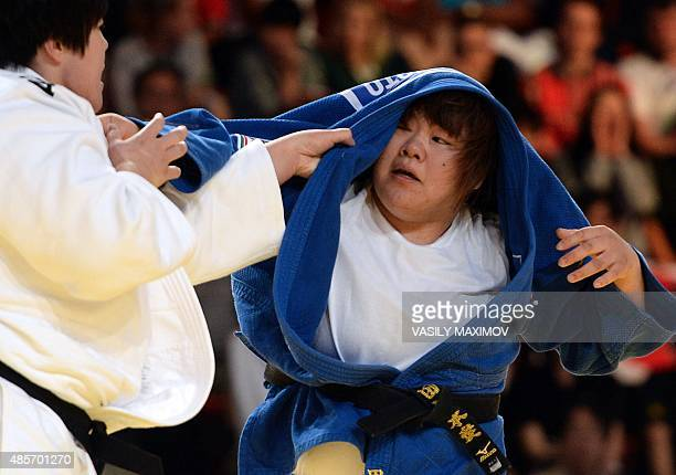 Chinas Yu Song competes with Japans Megumi Tachimoto during the womens gold medal match in the 78kg category at the Judo World Championships in...