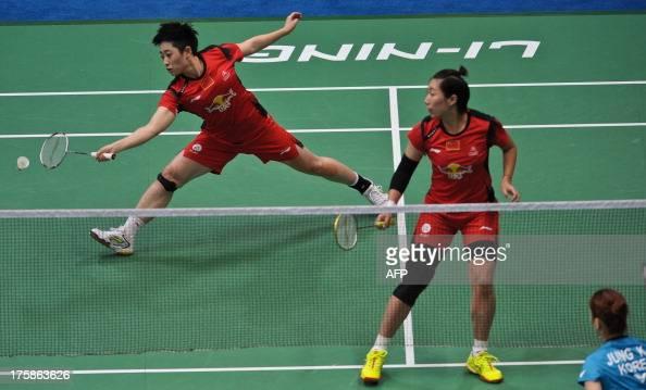 China's Yu Yang and Wang Xiaoli return to South Korean pair Jung Kyungeun and Kim Hana during their women's double quarterfinal at World Badminton...