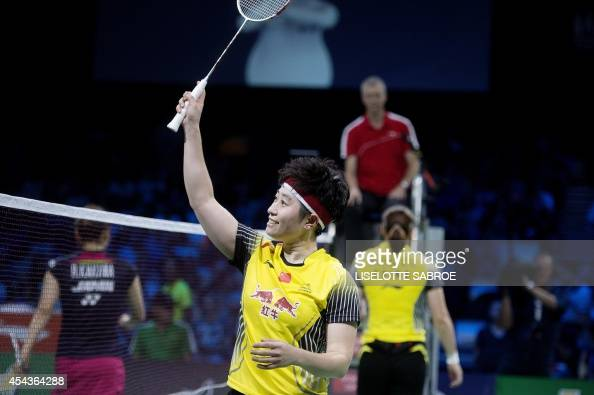 China's Yu Yang celebrates after playing with Wang Xiaoli against Japan's team during the women's double semi final match at the 2014 BWF Badminton...