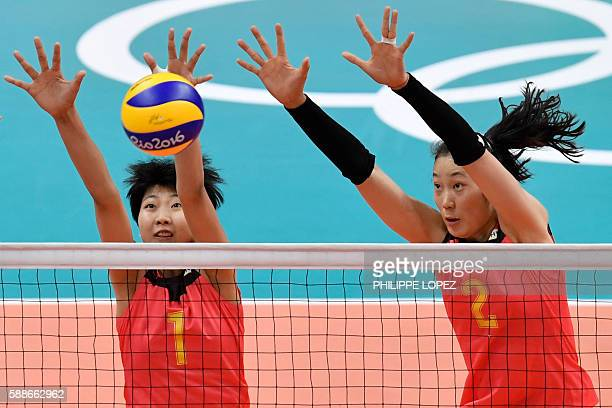 China's Yuan Xinyue and China's Zhu Ting jump up to block the ball during the women's qualifying volleyball match between China and Serbia at...