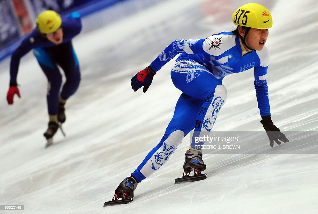 China's Zhang Jiahao (L) chases Ye Wei (R) while competing in the men's programme of the National Short Track Speed Skating competition in Beijing on January 7, 2010, from where some atheletes will get to represent China at the 2010 Vancouver winter Olympic Games. China made their winter Olympics debut at Lake Placid in 1990 but didn't win its first medals until Albertville in 1992 with two silvers in speed skating. Speed skating has since been China's strongest winter sport accounting for 25, or almost 80 percent of China's winter Olympic medals, including the nine won in Torino in 2006. AFP PHOTO/Frederic J. BROWN