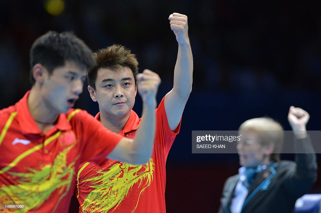 China's Zhang Jike (L) and China's Wang Hao celebrate scoring the winning point to win gold against South Korea's Oh Sangeun and South Korea's Ryu Seungmin during the table tennis men's team final China vs South Korea at the London Olympic games on August 8, 2012 at the Excel arena in London. AFP PHOTO / SAEED KHAN