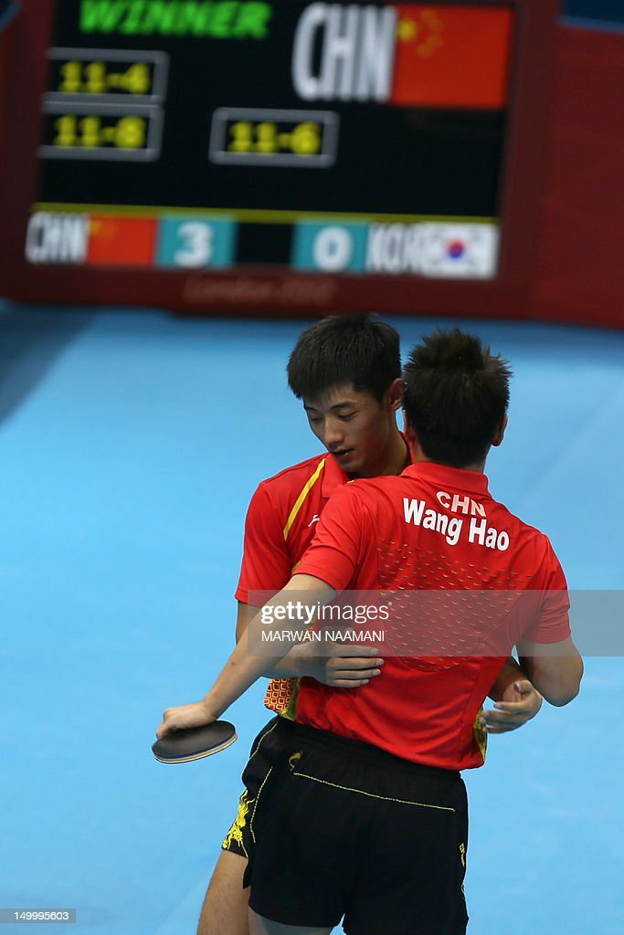 China's Zhang Jike (L) and China's Wang Hao celebrate scoring the winning point to win gold against South Korea's Oh Sangeun and South Korea's Ryu Seungmin during the table tennis men's team final China vs South Korea at the London Olympic games on August 8, 2012 at the Excel arena in London.