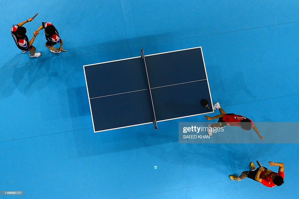 China's Zhang Jike and China's Wang Hao (R) celebrate scoring to win gold against South Korea's Oh Sangeun and South Korea's Ryu Seungmin during the table tennis men's team final China vs South Korea at the London Olympic games on August 8, 2012 at the Excel arena in London.