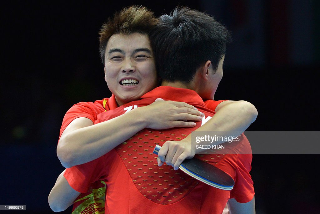 China's Zhang Jike (R) and China's Wang Hao celebrates scoring the winning point to win gold against South Korea's Oh Sangeun and South Korea's Ryu Seungmin during the table tennis men's team final China vs South Korea at the London Olympic games on August 8, 2012 at the Excel arena in London.