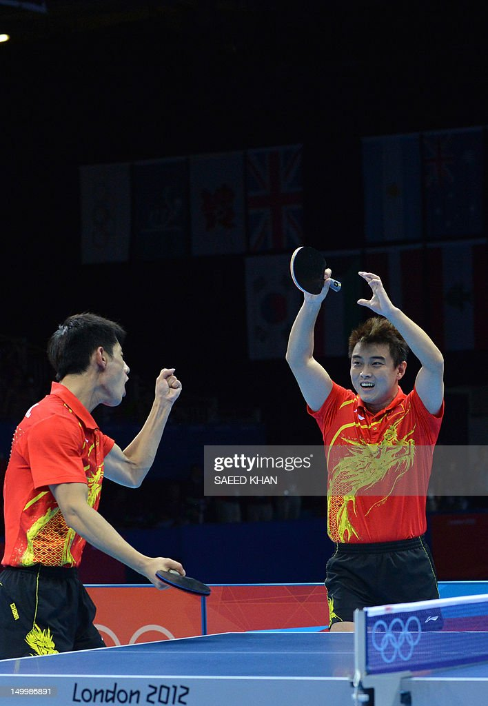 China's Zhang Jike (L) and China's Wang Hao celebrates scoring the winning point to win gold against South Korea's Oh Sangeun and South Korea's Ryu Seungmin during the table tennis men's team final China vs South Korea at the London Olympic games on August 8, 2012 at the Excel arena in London.