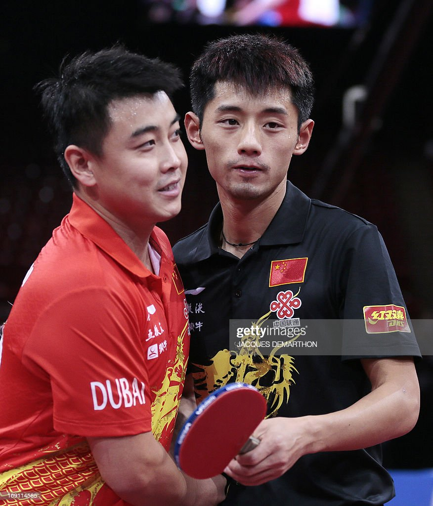China's Zhang Jike (R) congratulates China's Wang Hao (L) on May 20, 2013 in Paris, after he won the Final of the Men's Singles at the World Table Tennis Championships.