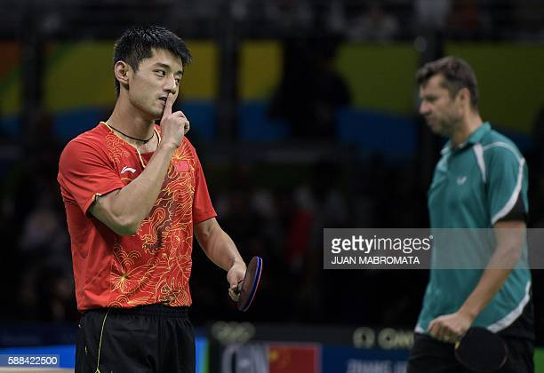 China's Zhang Jike reacts after beating Belarus' Vladimir Samsonov in their men's singles semifinal table tennis match at the Riocentro venue during...