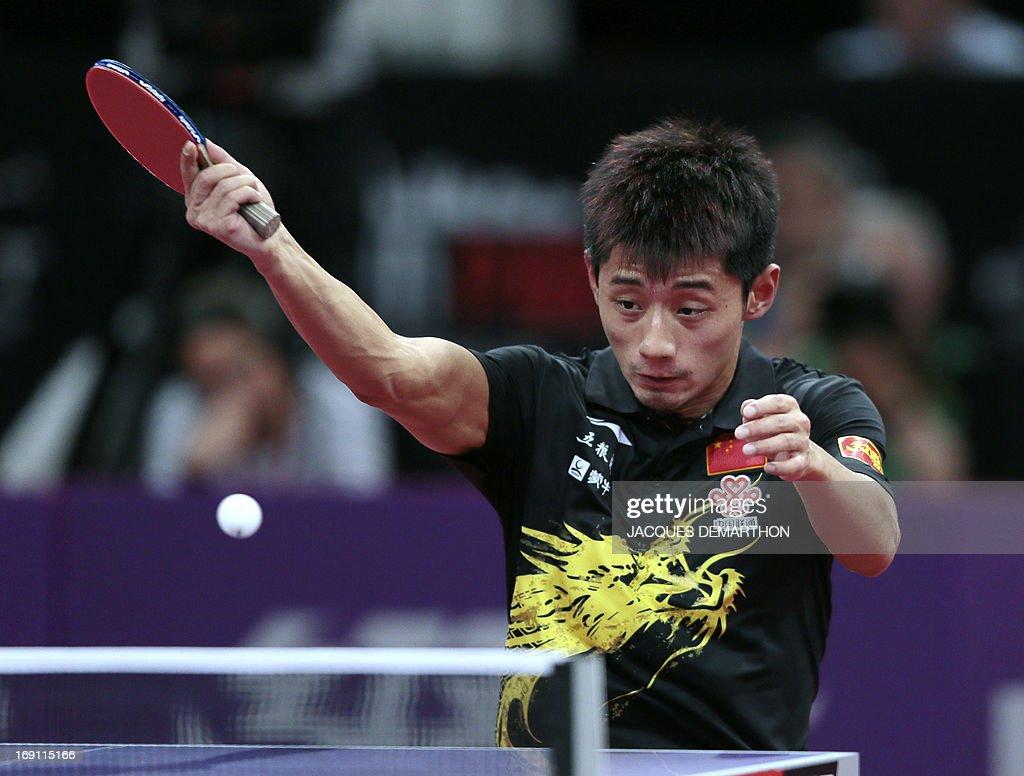 China's Zhang Jike returns a ball to China's Wang Hao during the Men's Singles final of the World Table Tennis Championships, on May 20, 2013 in Paris. Zhang Jike won the final. AFP PHOTO/JACQUES DEMARTHON