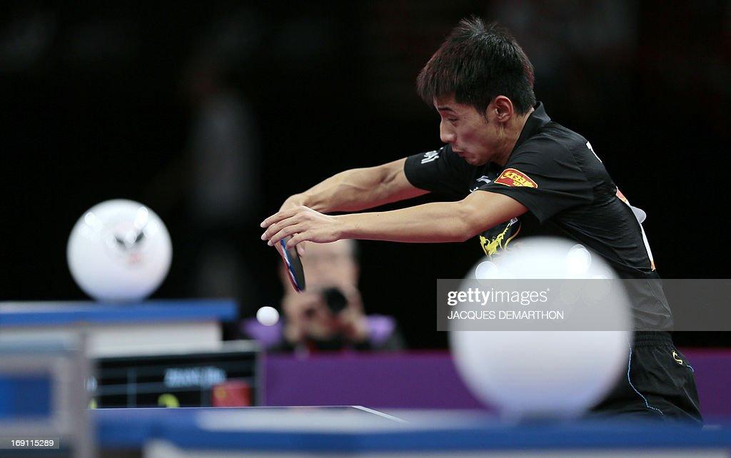 China's Zhang Jike returns a ball to China's Wang Hao during the Men's Singles final of the World Table Tennis Championships on May 20, 2013 in Paris. Zhang Jike won the final. AFP PHOTO/JACQUES DEMARTHON