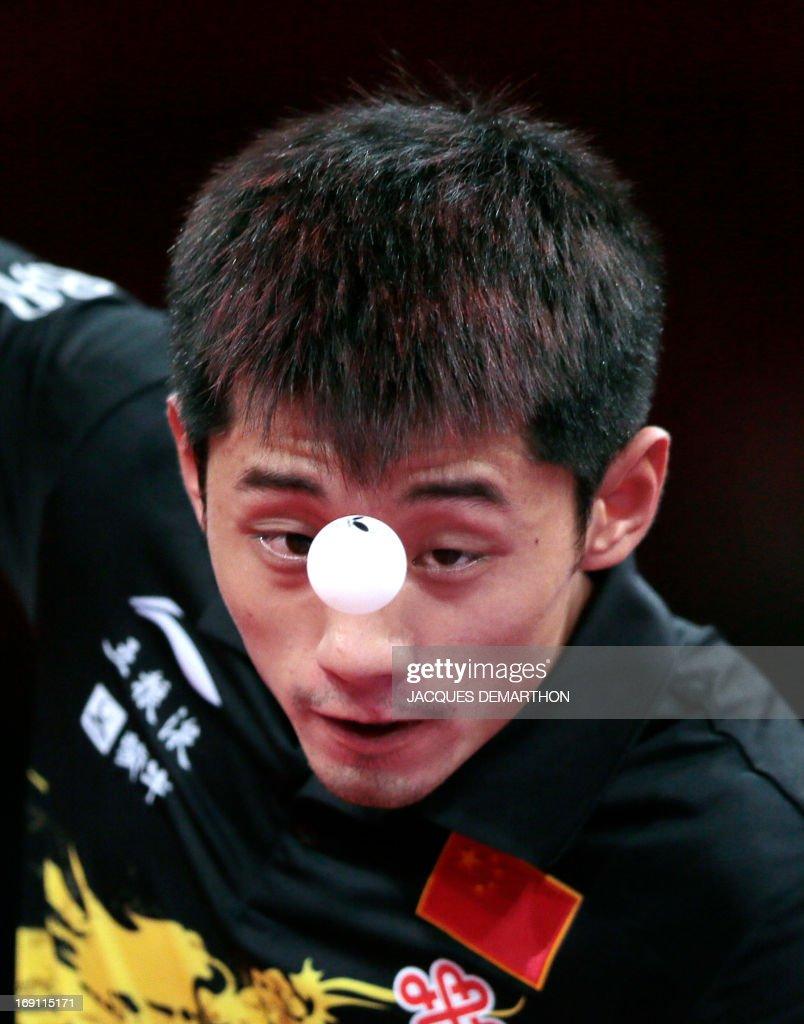China's Zhang Jike serves to China's Wang Hao during the Men's Singles final of the World Table Tennis Championships, on May 20, 2013 in Paris. Zhang Jike won the final.