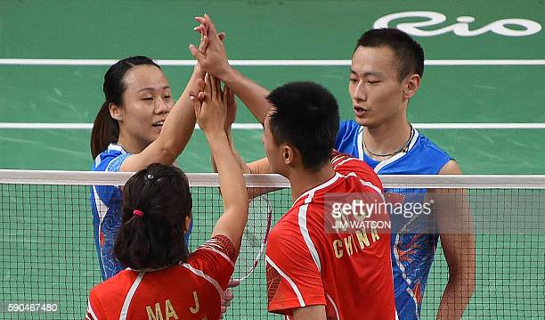 China's Zhang Nan and China's Zhao Yunlei react after winning against China's Xu Chen and China's Ma Jin during their mixed doubles Bronze Medal...