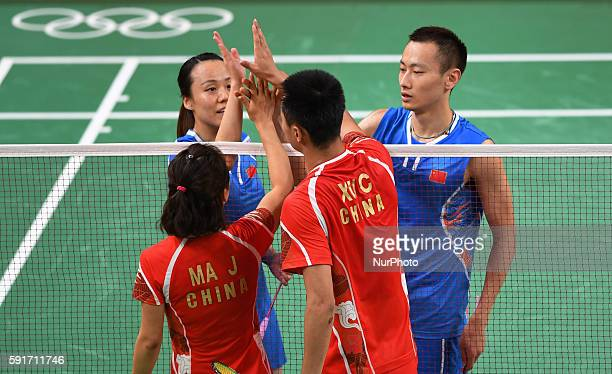 China's Zhang Nan and Zhao Yunlei greet Xu Chen and Ma Jin after the mixed doubles bronze medal match of Badminton at the 2016 Rio Olympic Games in...