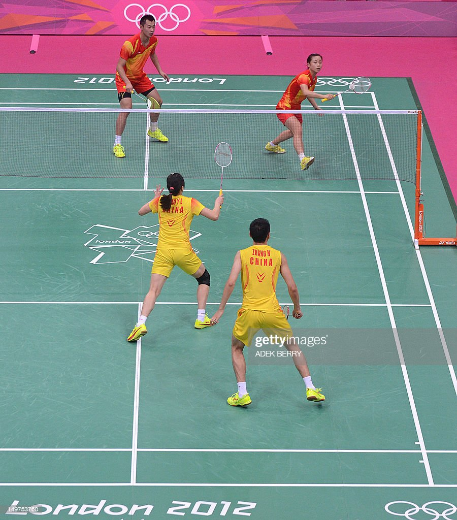 China's Zhang Nan (Front R) and Zhao Yunlei (Front L) play against compatriots Xu Chen (Top L) and Ma Jin (Top R) in the Mixed Doubles gold medal match at the London 2012 Olympic Games in London, on August 3, 2012.
