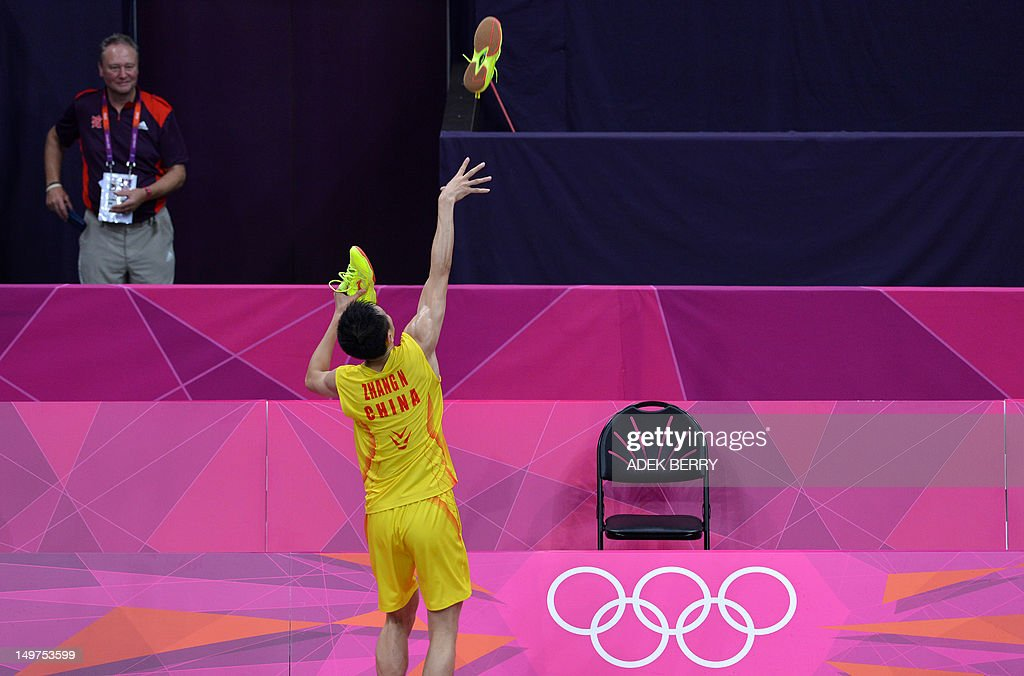 China's Zhang Nan throws his shoes into the crowd after he and partner Zhao Yunlei beat compatriots Xu Chen and Ma Jin in the Mixed Doubles gold medal match at the London 2012 Olympic Games in London, on August 3, 2012.