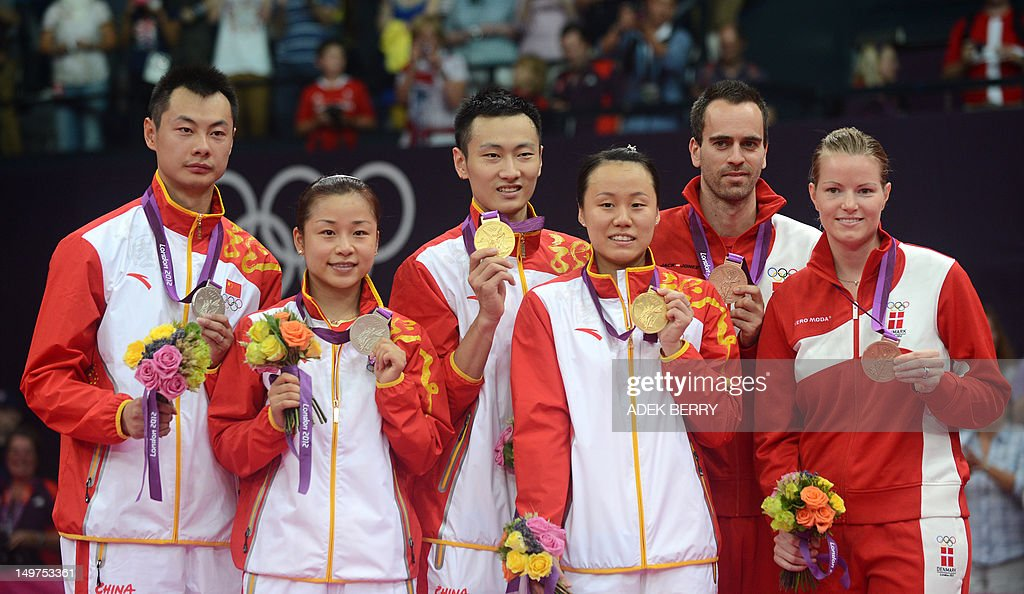 China's Zhang Nan, (3rd L) Zhao Yunlei, (3rd R) compatriots Xu Chen (L) and Ma Jin (2nd L) and Denmarks Christinna Pedersen (R) and Joachim Fischer (2nd R) pose with their gold, silver and bronze medals after the Mixed Doubles medal matches at the London 2012 Olympic Games in London, on August 3, 2012.