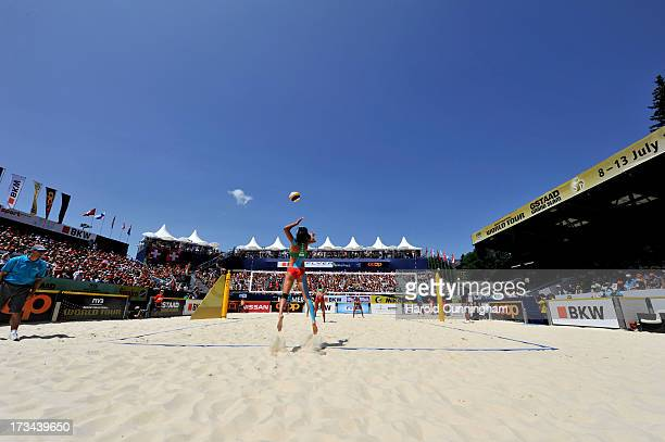 China's Zhang Xi serves during the LiliSeixas v XueZhang Xi final match as part of the FIVB Gstaad Grand Slam sixth day on July 14 2013 in Gstaad...