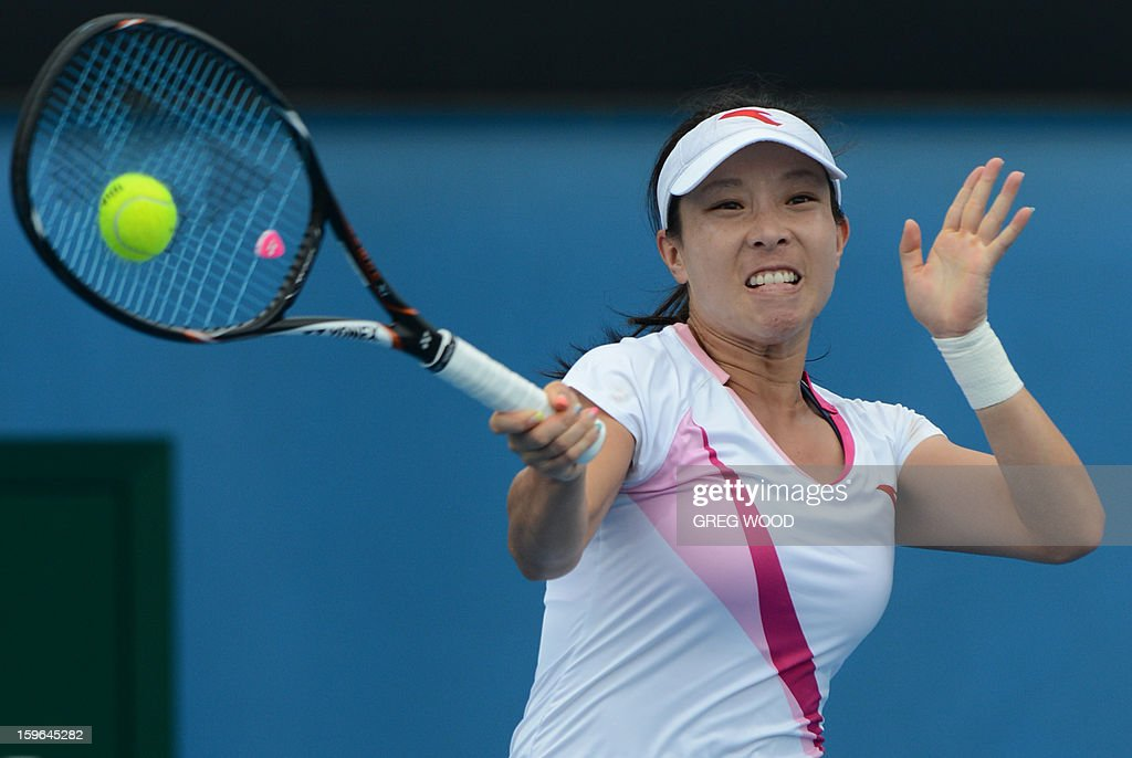 China's Zheng Jie plays a return during her women's singles match against Germany's Julia Goerges on the fifth day of the Australian Open tennis tournament in Melbourne on January 18, 2013. AFP PHOTO/GREG WOOD IMAGE STRICTLY RESTRICTED TO EDITORIAL USE - STRICTLY NO COMMERCIAL USE