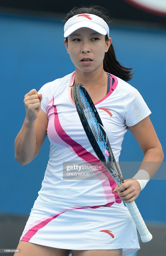 China's Zheng Jie reacts during her women's singles match against Germany's Julia Goerges on the fifth day of the Australian Open tennis tournament in Melbourne on January 18, 2013.