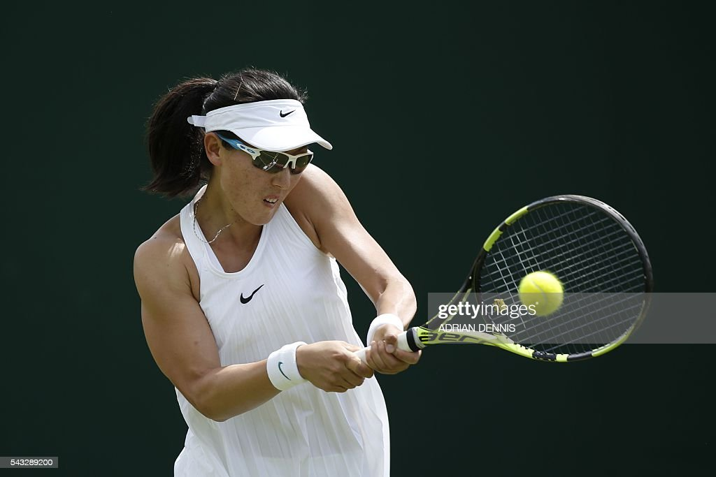 China's Zheng Saisai hits a return against Greece's Maria Sakkari during their women's singles first round match on the first day of the 2016 Wimbledon Championships at The All England Lawn Tennis Club in Wimbledon, southwest London, on June 27, 2016. / AFP / ADRIAN
