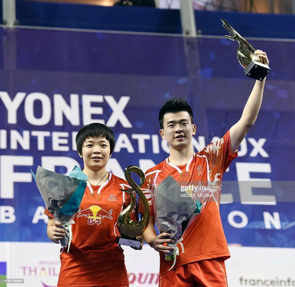 China s Zheng Siwei R and Chen Qingchen pose after winning