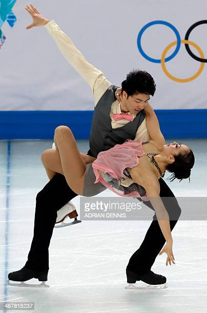 China's Zheng Xun and China's Huang Xintong perform in the Figure Skating Team Ice Dance Short Dance at the Iceberg Skating Palace during the Sochi...