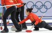China's Zhou Yan delivers the stone during their bronze medal match against Switzerland in the Vancouver Winter Olympics women's curling game at the...