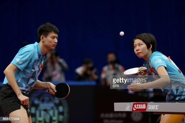 China's Zhou Yu and Chen Xingtong play during the mixed doubles final match against Japan's Ito Mima and Morizono Masataka at the Asian Table Tennis...
